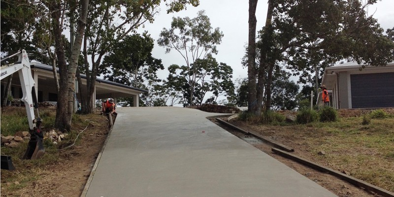 Steep exposed aggregate concrete driveway, ready to be hosed to expose the hidden stone. Concreting by Shane Palmer.