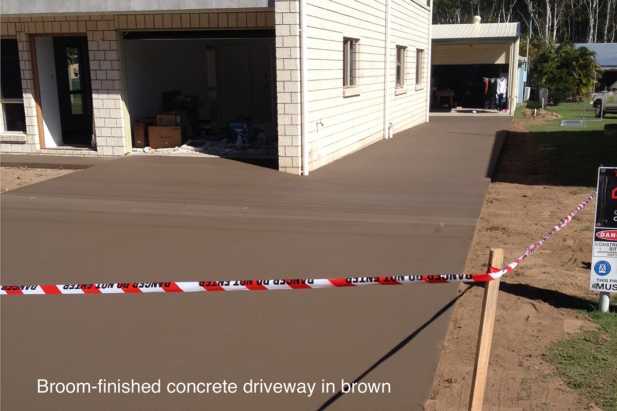 Broom-finished concrete driveway in brown. Concreting by Shane Palmer.