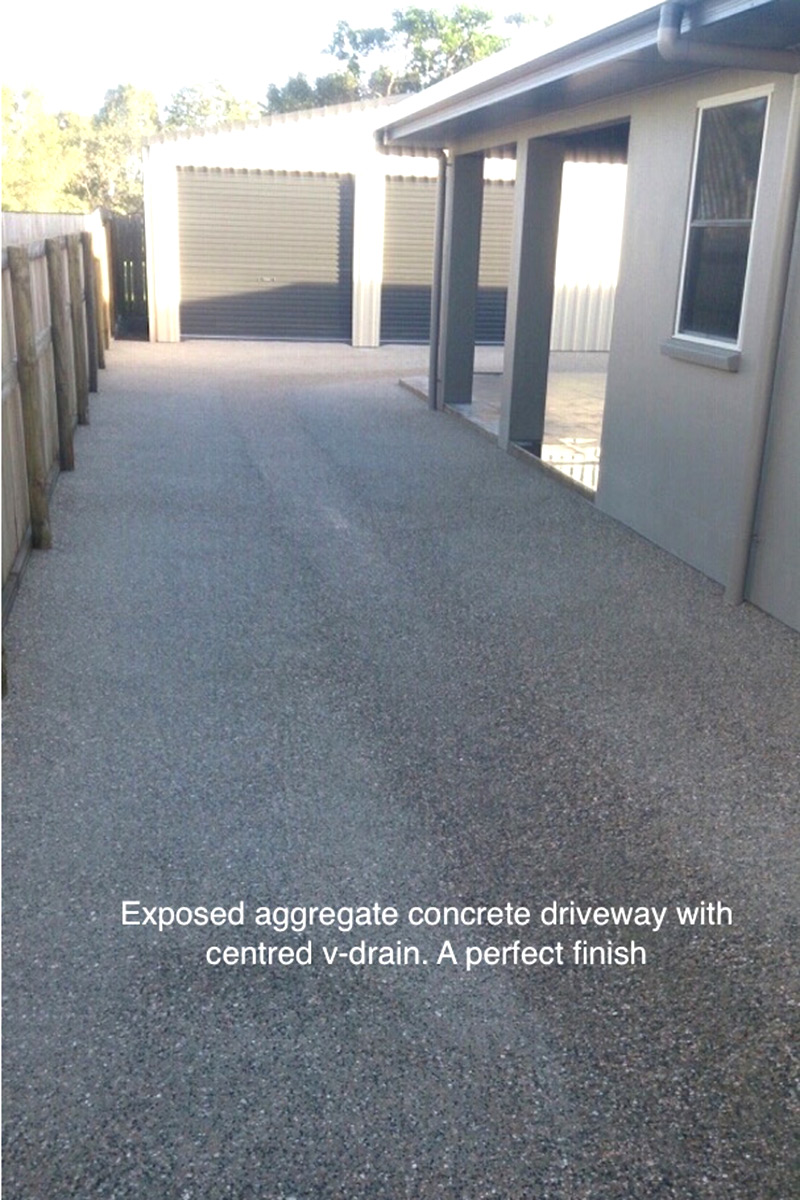 Exposed aggregate concrete driveway with centred v-drain. Concreting by Shane Palmer.